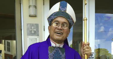 Archbishop Anthony Apuron stands in front of the Dulce Nombre de Maria Cathedral Basilica in Hagatna, Guam.