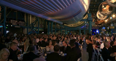 The black-tie Apollo Celebration Gala is held under a Saturn V rocket at the Kennedy Space Center in Cape Canaveral, Fla., on Saturday, July 21, 2018.