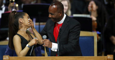 Ariana Grande, left, laughs with Bishop Charles H. Ellis during the funeral service for Aretha Franklin at Greater Grace Temple, Friday, Aug. 31, 2018, in Detroit. Franklin died Aug. 16, 2018 of pancreatic cancer at the age of 76.