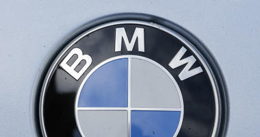 In this Aug. 1, 2017 file photo the brand logo of German car maker BMW is photographed on a car in Berlin.
