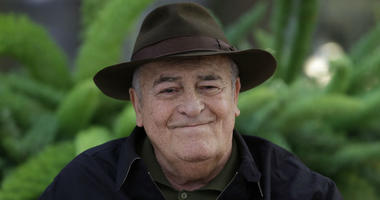 In this file photo taken on Oct. 18, 2012, Italian film director Bernardo Bertolucci poses for photographers during a photo call in Rome.