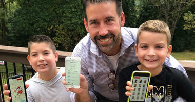Brad Line of Villanova and his sons, Grayson and Nolan, showing off their app, Squishr, for tracking spotted lanternflies.