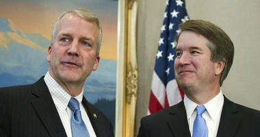 Supreme Court nominee Brett Kavanaugh, right, stands with Sen. Dan Sullivan, R-Alaska, before the start of their meeting, Thursday, July 12, 2018, on Capitol Hill in Washington.