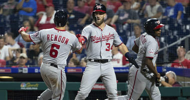 Washington Nationals' Bryce Harper, center, celebrates with Anthony Rendon, left, on his two-run home run during the ninth inning of a baseball game against the Philadelphia Phillies, Tuesday, Aug. 28, 2018, in Philadelphia.