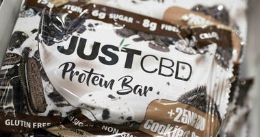 A cookies and cream flavored protein bar marketed by JustCBD is displayed at the Cannabis World Congress & Business Exposition trade show, Thursday, May 30, 2019 in New York.