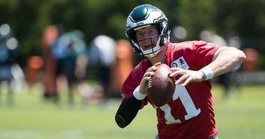 Philadelphia Eagles quarterback Carson Wentz (11) runs a drill during minicamp at Novacare Complex.
