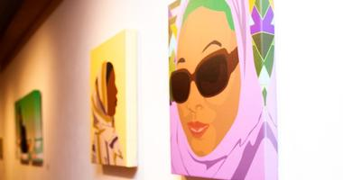 """Titled """"Covered,"""" Yusef Abdule Jaleel's exhibition features rotoscope digital illustrations in vibrant colors, depicting Muslim women of color in striking, powerful poses and in modest fashion."""