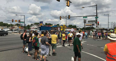 Sixteen police cars lined the street near 28th Street and Passyunk Avenue in South Philadelphia Tuesday afternoon as protesters, who say they want the Philadelphia Energy Solutions refinery shut down, blocked the intersection into the plant.