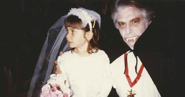 Jay Lloyd dressed as Dracula poses with his daughter during a Halloween years ago.