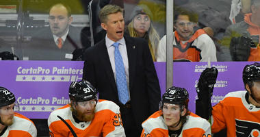 Philadelphia Flyers head coach Dave Hakstol behind the bench against the Ottawa Senators during the third period at Wells Fargo Center.