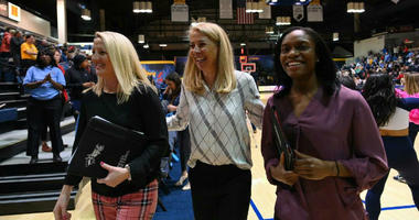Drexel head coach Denise Dillon flanked by associate head coach Amy Mallon (left) and assistant Michelle Baker (right).