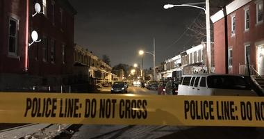 Police are searching for a man they believe shot his girlfriend, who was found feet away from the crib of her newborn daughter.