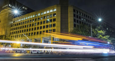 In this Nov. 1, 2017, file photo, traffic along Pennsylvania Avenue in Washington streaks past the Federal Bureau of Investigation headquarters building.