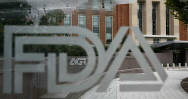 This Thursday, Aug. 2, 2018, file photo shows the U.S. Food and Drug Administration building behind FDA logos at a bus stop on the agency's campus in Silver Spring, Md.
