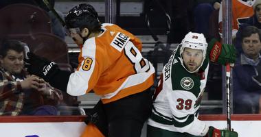 Philadelphia Flyers' Robert Hagg, left, collides with Minnesota Wild's Nate Prosser during the third period of an NHL hockey game, Monday, Jan. 14, 2019, in Philadelphia. Philadelphia won 7-4.
