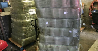Pallets containing sealed packages of blankets for the homeless are delivered to The Bethesda Project on Monday morning by Philadelphia Flyers Charities.