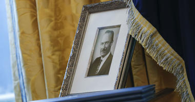 In this Feb. 9, 2017, file photo, a portrait of President Donald Trump's father Fred Trump, and three un-signed Executive orders are seen in the Oval Office of the White House in Washington.