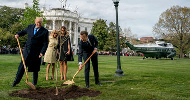 Trump and Macron plant a tree