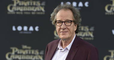 """In this May 18, 2017, file photo, Geoffrey Rush arrives at the Los Angeles premiere of """"Pirates of the Caribbean: Dead Men Tell No Tales"""" at the Dolby Theatre."""