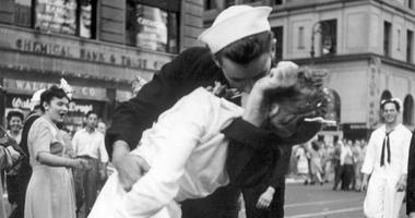A sailor and a woman kiss in New York's Times Square, as people celebrate the end of World War II.