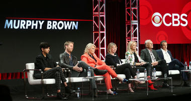 """From left: Actor Nik Dodani, actor Jake McDorman, actress Candice Bergen, executive producer Diane English, actress Faith Ford, actor Joe Regalbuto, and actor Grant Shaud of the television show """"Murphy Brown"""" speak on Aug. 5, 2018."""