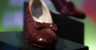 The 'ruby slippers' which Judy Garland wore during the 1939 filming of The Wizard of Oz are put on display during a press preview for the exhibit 'Ray Dolby Gateway to American Culture' at the Smithsonian National Museum of American History.