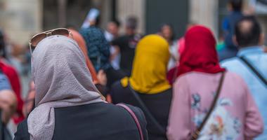 Women are shown wearing head scarves