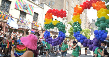 Part of the NYC Pride March moves past the Stonewall Inn in New York's Greenwich Village.