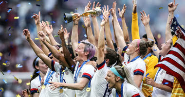 Megan Rapinoe of the USA lifts the FIFA Women's World Cup Trophy following her team's victory in the 2019 FIFA Women's World Cup France Final match between The United States of America and The Netherlands at Stade de Lyon on July 07, 2019 in Lyon, France.