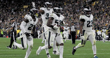 Nigel Bradham #53 of the Philadelphia Eagles celebrates with teammates after making an interception in the fourth quarter against the Green Bay Packers at Lambeau Field.