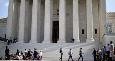 People wait in line with hundreds of others for the chance to attend arguments outside the U.S. Supreme Court building at the start of the court's new term October 07, 2019 in Washington, DC.