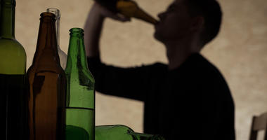 Teen male drinking alcohol.