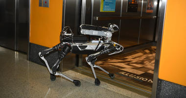 SpotMini Boston Dynamics Marc Raibert's dog-like robot enters the elevator during Genius Gala 6.0 at Liberty Science Center on May 5, 2017 in Jersey City, New Jersey.
