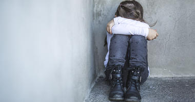 A girl being bullied.