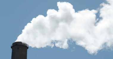 Emissions rise out of a large smoke stack at Pacificorp's 1000 megawatt coal fired power plant on October 9, 2017 outside Huntington, Utah.
