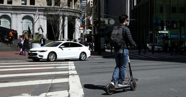 SAN FRANCISCO, CA - APRIL 17: A user rides a Bird scooter on April 17, 2018 in San Francisco, California.