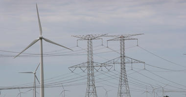 Power lines and power generating windmills