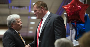 GOP chair Buddy Burkhardt, left, shakes the hand of Glenn Jacobs after early results showed Jacobs winning the mayoral race, Thursday, Aug. 2, 2018, in Knoxville, Tenn.