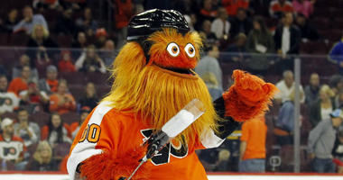 In this Sept. 24, 2018 file photo, the Philadelphia Flyers mascot, Gritty, takes to the ice during the first intermission of the Flyers' preseason NHL hockey game against the Boston Bruins in Philadelphia.
