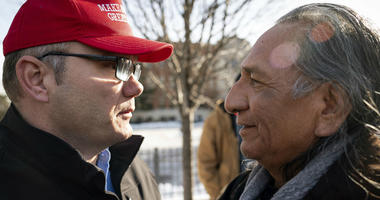 Guy Jones, left, and a supporter of President Donald Trump named Don embrace during a gathering of Native American supporters in front of the Catholic Diocese of Covington in Covington, Ky., Tuesday, Jan. 22, 2019.