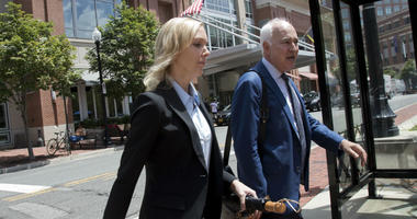Paul Manafort's former bookkeeper Heather Washkuhn, walks to the Alexandria Federal Courthouse in Alexandria, Va., Thursday, Aug. 2, 2018, to testify at the trial of President Donald Trump's former campaign chairman's tax evasion and bank fraud trial.