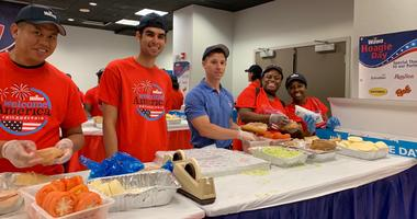 Wawa Hoagie Day workers assemble 32,000 sandwiches from 18,000 lbs. of ingredients.