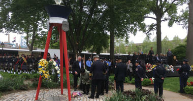 Another name is added to the Living Flame Memorial at Franklin Square Park as each year, the service honors police officers and firefighters who have died in the line of duty.