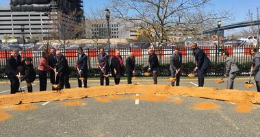 Officials symbolically broke ground on luxury high rise 11 Cooper.