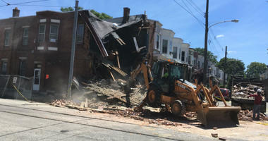 There was a partial rowhome collapse Monday in East Mount Airy at a small intersection where a flatbed truck drove into its living room.