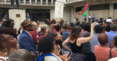 About 100 demonstrators protested at Philadelphia Police headquarters.