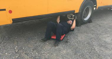 Mechanic inspects a school bus.