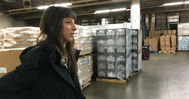 Samantha Mogil, manager of government and community affairs for Share Food Program, says in the organization's warehouse that the nonprofit will provide free food for furloughed workers.