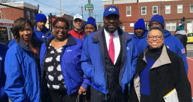 Councilman Kenyatta Johnson with Urban League director Charlene Matlock Turner and workers and officials from Ready, Willing and Able.
