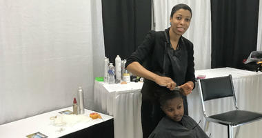 Barbers offered free haircuts for kids during the event.